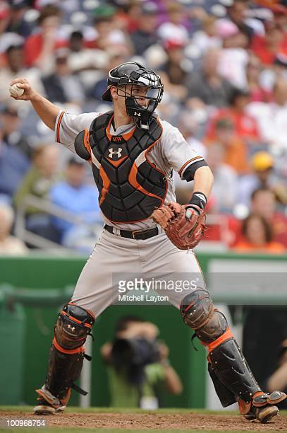 Matt Wieters of the Baltimore Orioles throws to second base during a baseball game against the Washington Nationals on May 23 2010 at Nationals Park...