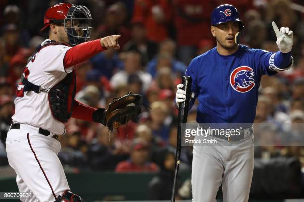 Matt Wieters of the Washington Nationals and Albert Almora Jr #5 of the Chicago Cubs react to the first base umpire's call during the third inning in...