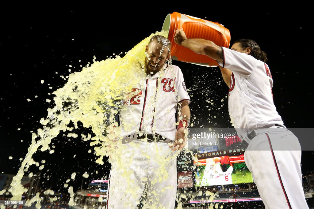 Matt Wieters #32 of the Washington Nationals has gatorade dumped on him by teammate Anthony Rendon #6 after hitting a single two run RBI walk-off during the ninth inning to defeat the Baltimore Orioles 7-6 at Nationals Park on May 10, 2017 in Washington, DC.