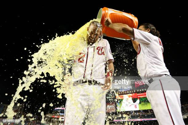 Matt Wieters of the Washington Nationals has gatorade dumped on him by teammate Anthony Rendon after hitting a single two run RBI walkoff during the...