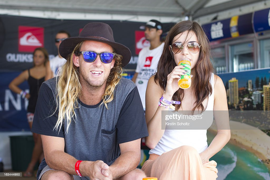 Matt WIlkinson of Australia sits with a friend in the competitors area during the Quiksilver Pro on March 10, 2013 in Gold Coast, Australia.