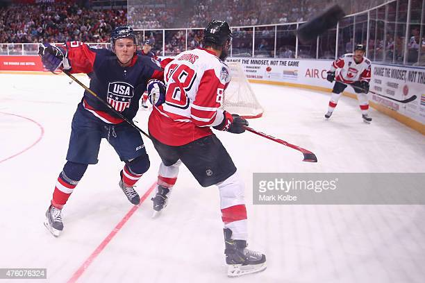 Matt Williams of the United States of America watches on as the puck hits the glass during the 2015 Ice Hockey Classic match between the Unites...