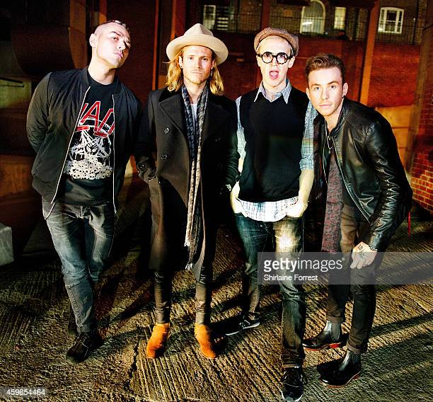 Matt Willis Dougie Poynter Tom Fletcher and Danny Jones of McBusted pose backstage at HMV on November 26 2014 in Leeds England