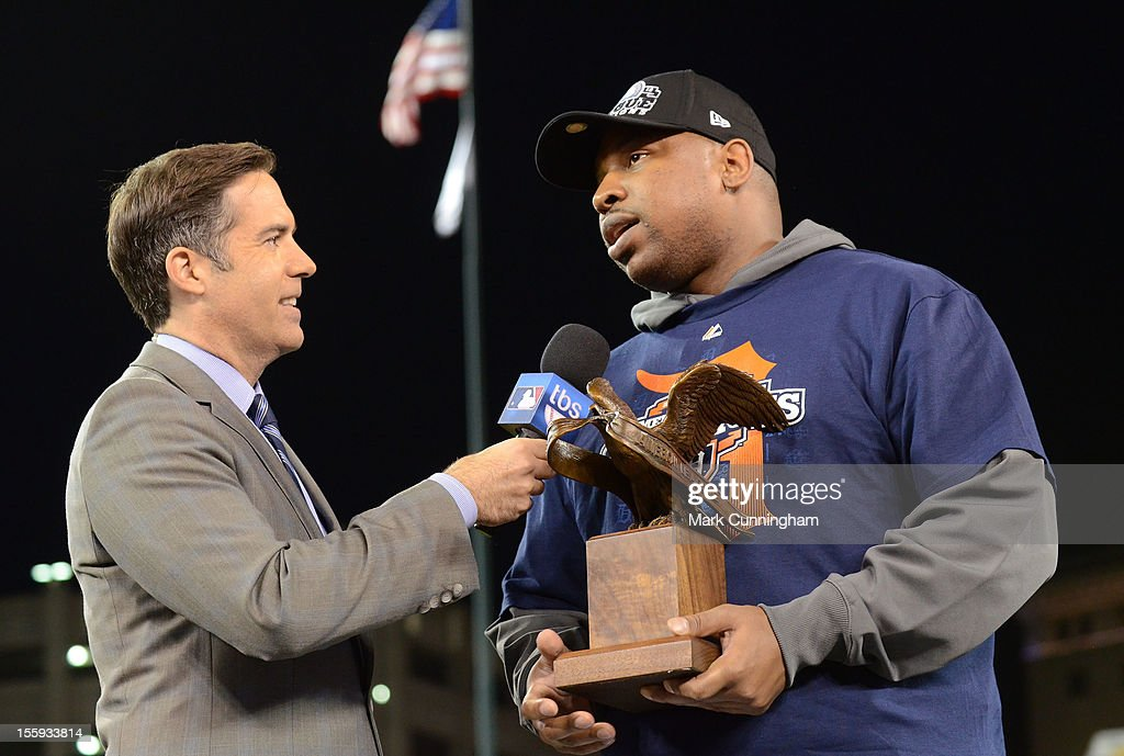 Matt Winer of TBS presents Delmon Young #21 of the Detroit Tigers with the 2012 ALCS MVP Trophy after the victory against the New York Yankees in Game Four of the American League Championship Series at Comerica Park on October 18, 2012 in Detroit, Michigan. The Tigers defeated the Yankees 8-1 and now advance to the World Series.
