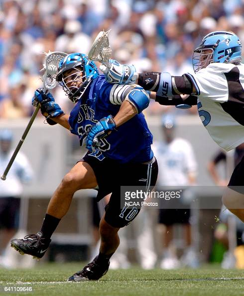 Matt Zash of Duke drives to the goal while being defended by Matt Feild of Hopkins during the Division I Men's Lacrosse Championship help at Lincoln...