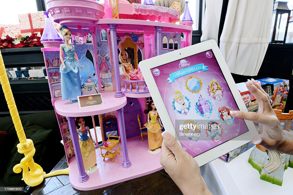 A Mattel Inc. representative displays the Disney Princess Ultimate Dream Castle and its Apple Inc. iPad application at the company's Get Your Santa Together event in New York, U.S., on Thursday, June 20, 2013. Mattel, Inc., a toy manufacturing company founded in 1945, produces brands that include Fisher Price, Barbie dolls, Monster High dolls, Hot Wheels and Matchbox toys, Masters of the Universe, American Girl dolls, board games, WWE Toys, and early-1980s video game systems. Photographer: Peter Foley/Bloomberg via Getty Images