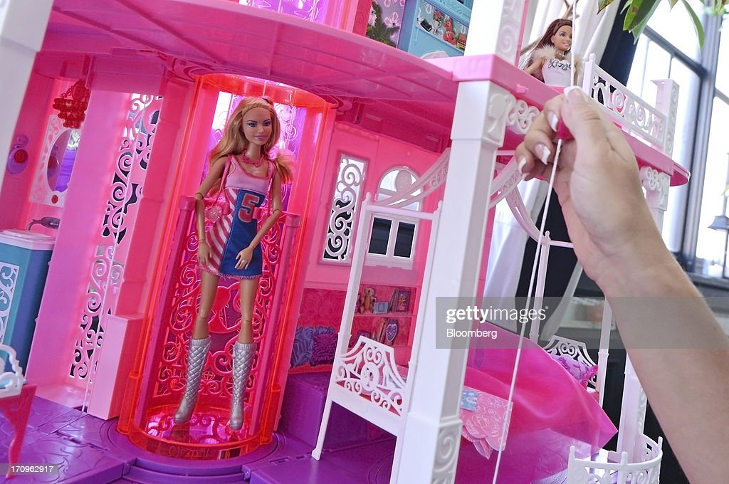 Mattel Inc.'s Barbie Dreamhouse sits on display at the company's Get Your Santa Together event in New York, U.S., on Thursday, June 20, 2013. Mattel, Inc., a toy manufacturing company founded in 1945, produces brands that include Fisher Price, Barbie dolls, Monster High dolls, Hot Wheels and Matchbox toys, Masters of the Universe, American Girl dolls, board games, WWE Toys, and early-1980s video game systems. Photographer: Peter Foley/Bloomberg via Getty Images