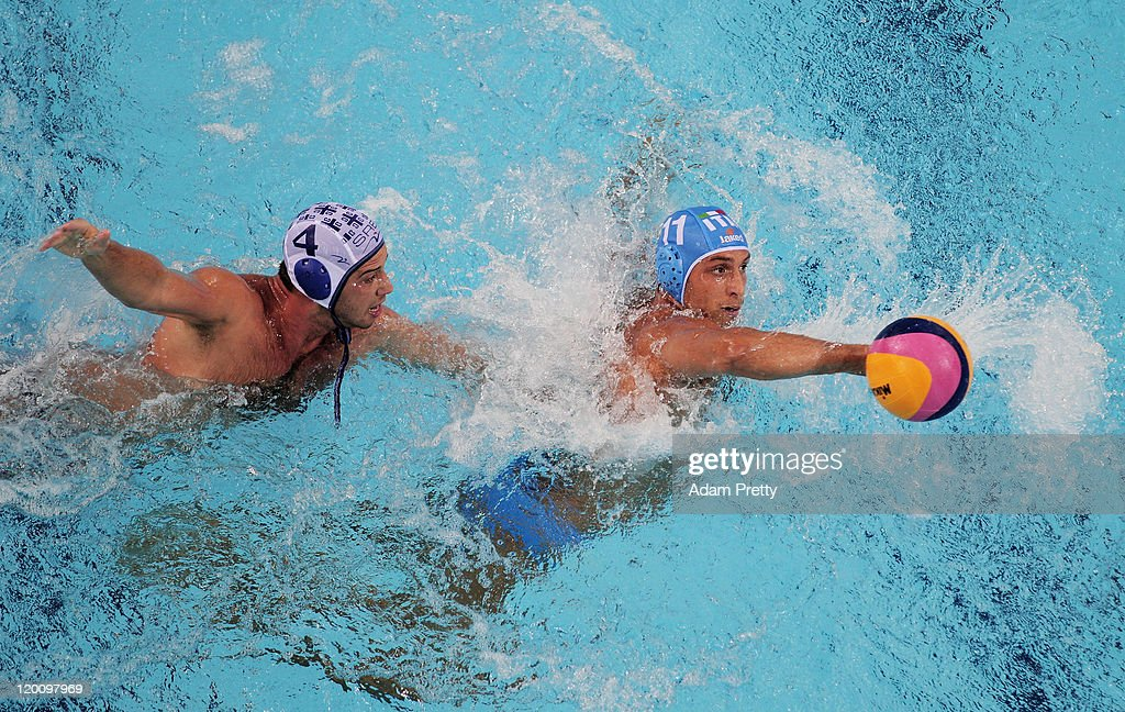 Matteo Aicardi of Italy is closed down by Vanja Udovicic of Serbia in the Men's Water Polo gold medal match between Serbia and Italy during Day...