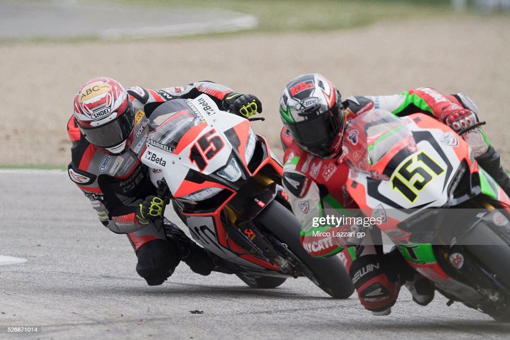 Matteo Baiocco of Italy and VFT Racing leads Alex De Angelis of Rep. San Marino and IodaRacing Team during the Superbike race 2 during the World Superbikes - Race at Enzo & Dino Ferrari Circuit on May 10, 2015 in Imola, Italy.