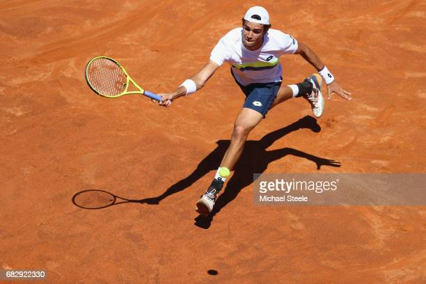 Matteo Berrettini of Italy stretches for a return during his first round match against Fabio Fognini of Italy on Day Two of The Internazionali BNL...