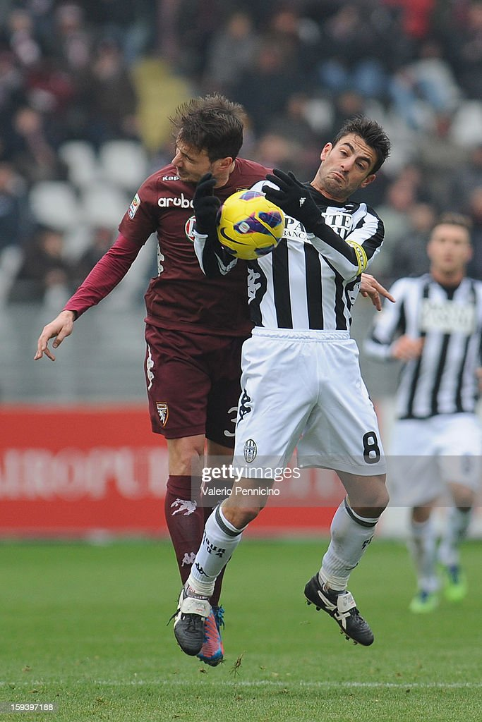 Matteo Brighi (L) of Torino FC clashes with Simone Vergassola of AC Siena during the Serie A match between Torino FC and AC Siena at Stadio Olimpico di Torino on January 13, 2013 in Turin, Italy.
