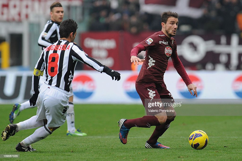Matteo Brighi (R) of Torino FC in action against Simone Vergassola of AC Siena during the Serie A match between Torino FC and AC Siena at Stadio Olimpico di Torino on January 13, 2013 in Turin, Italy.