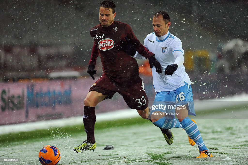 Matteo Brighi (L) of Torino FC is challenged by Matteo Brighi of S.S. Lazio during the Serie A match between Torino FC and S.S. Lazio at Stadio Olimpico di Torino on March 17, 2013 in Turin, Italy.