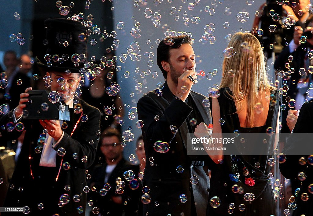 Matteo Ceccarini and actress <a gi-track='captionPersonalityLinkClicked' href=/galleries/search?phrase=Eva+Riccobono&family=editorial&specificpeople=885062 ng-click='$event.stopPropagation()'>Eva Riccobono</a> blow bubbles during the 'Tracks' Premiere during the 70th Venice International Film Festival on August 29, 2013 in Venice, Italy.