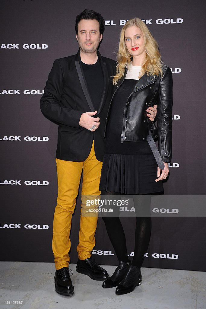 Matteo Ceccarini and <a gi-track='captionPersonalityLinkClicked' href=/galleries/search?phrase=Eva+Riccobono&family=editorial&specificpeople=885062 ng-click='$event.stopPropagation()'>Eva Riccobono</a> attend Diesel Black Gold fashion show during Pitti Immagine Uomo 85 on January 8, 2014 in Florence, Italy.