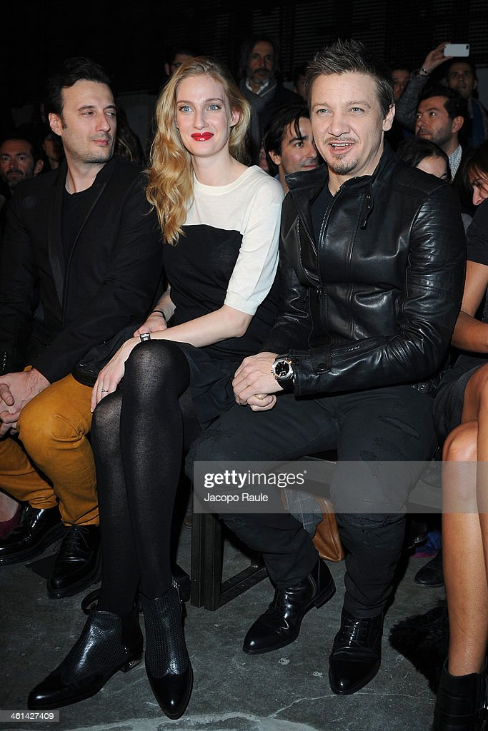 Matteo Ceccarini, Eva Riccobono and Jeremy Renner attend Diesel Black Gold fashion show during Pitti Immagine Uomo 85 on January 8, 2014 in Florence, Italy.