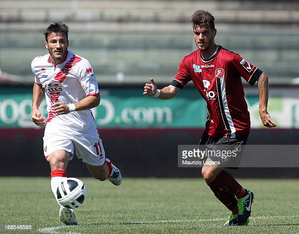 Matteo D'Alessandro of Reggina competes for the ball with Federico Piovaccari of Grosseto during the Serie B match between Reggina Calcio and US...