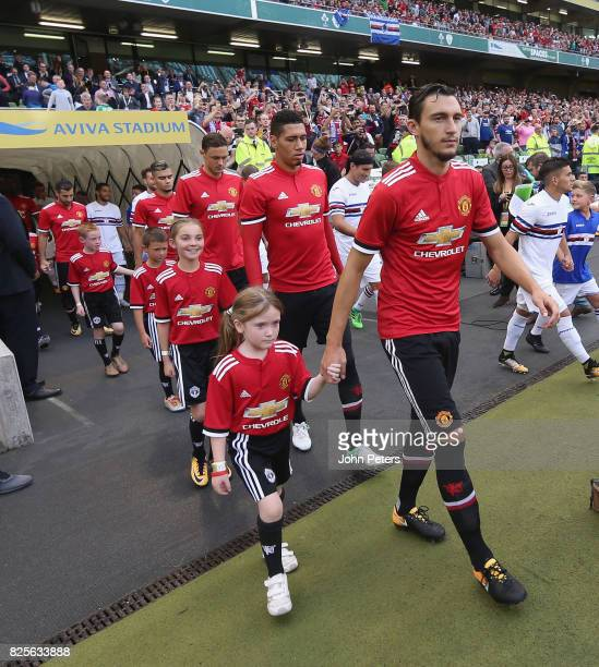 Matteo Darmian and Chris Smalling of Manchester United walk out with the United team ahead of the International Champions Cup preseason friendly...