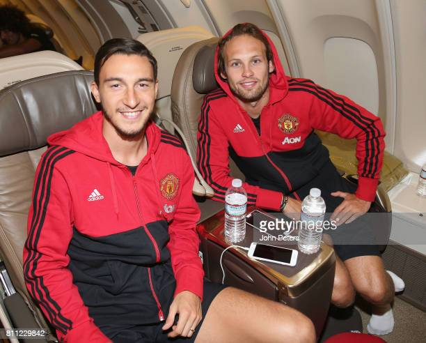 Matteo Darmian and Daley Blind of Manchester United sit on the aeroplane ahead of the club's preseason tour of the USA at Manchester Airport on July...