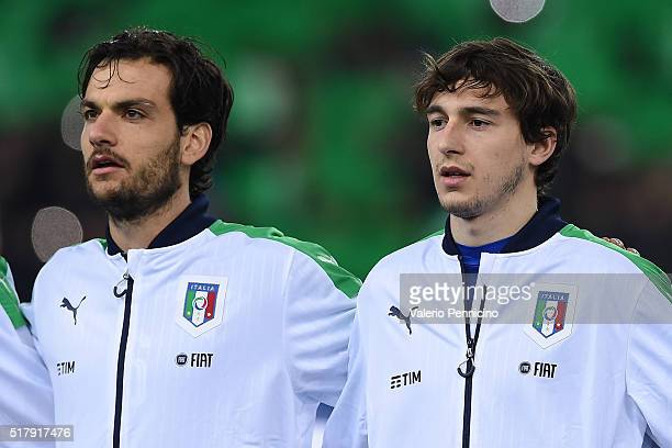Matteo Darmian and Marco Parolo of Italy looks on during the international friendly match between Italy and Spain at Stadio Friuli on March 24 2016...