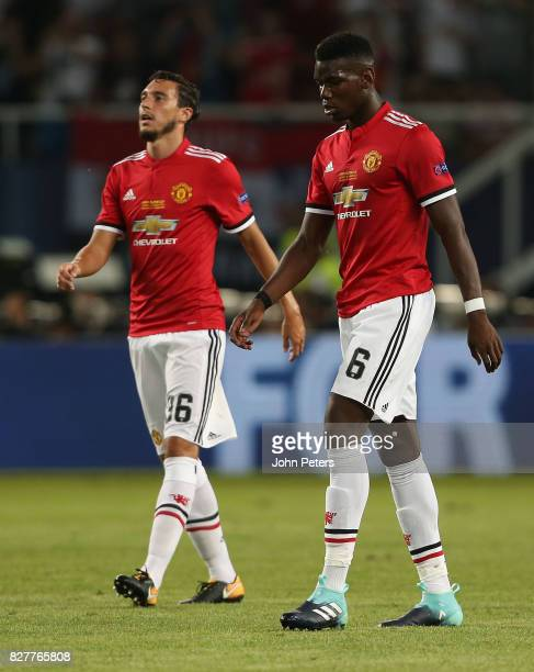 Matteo Darmian and Paul Pogba of Manchester United react to Real Madrid scoring their second goal during the UEFA Super Cup match between Real Madrid...