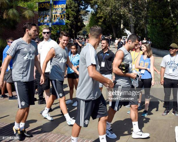Matteo Darmian Ander Herrera and Henrikh Mkhitaryan of Manchester United arrive for a training session for Tour 2017 at UCLA's Drake Stadium July 10...