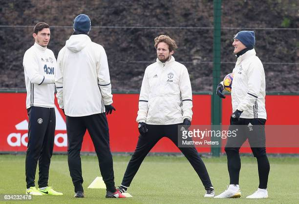 Matteo Darmian Daley Blind and Bastian Schweinsteiger of Manchester United in action during a first team training session at Aon Training Complex on...