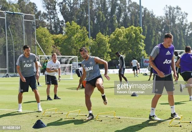 Matteo Darmian Henrikh Mkhitaryan and Phil Jones of Manchester United during a training session for Tour 2017 July 14 in Los Angeles California