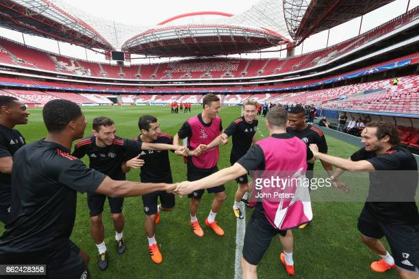 Matteo Darmian Henrikh Mkhitaryan Nemanja Matic Scott McTominay Antonio Valencia and Daley Blind of Manchester United in action during a training...