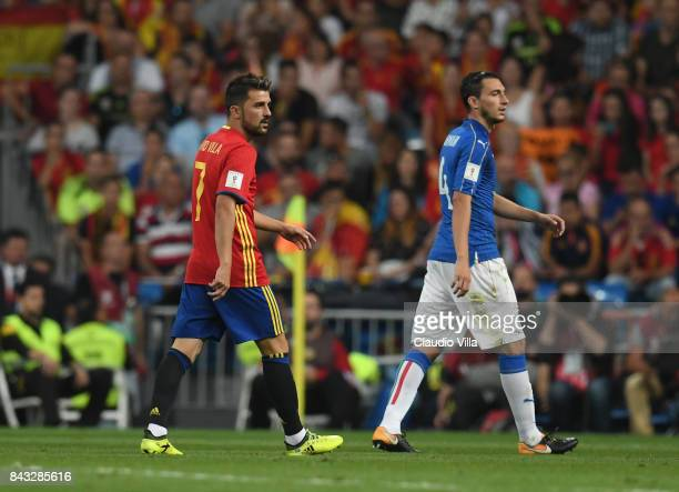 Matteo Darmian of Italy and David Villa of Spain look on look on during the FIFA 2018 World Cup Qualifier between Spain and Italy at Estadio Santiago...