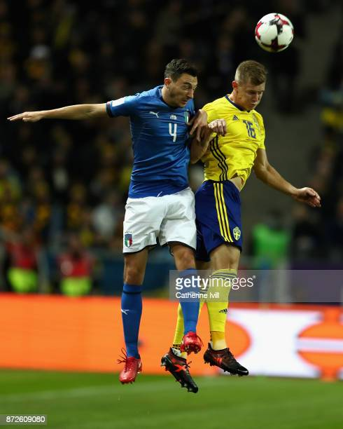 Matteo Darmian of Italy and Emil Krafth of Sweden battle for possession in the air during the FIFA 2018 World Cup Qualifier PlayOff First Leg between...