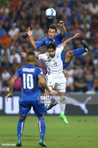 Matteo Darmian of Italy and Lior Rafaelov of Israel during FIFA World Cup Qualifier Group G match between Italy and Israel at Mapei Stadium in Reggio...