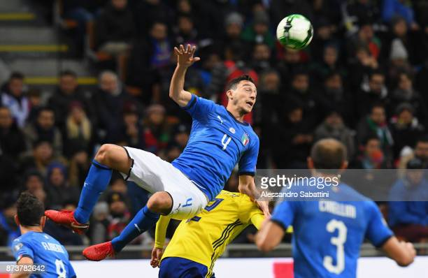 Matteo Darmian of Italy competes for the ball whit Mikael Lusting of Sweden during the FIFA 2018 World Cup Qualifier PlayOff Second Leg between Italy...