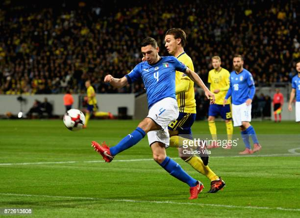 Matteo Darmian of Italy competes for the ball with Albin Ekdal of Sweden during the FIFA 2018 World Cup Qualifier PlayOff First Leg between Sweden...