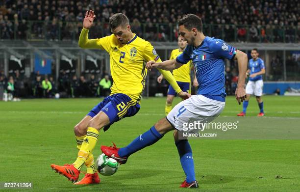 Matteo Darmian of Italy competes for the ball with Mikael Lustig of Sweden during the FIFA 2018 World Cup Qualifier PlayOff Second Leg between Italy...