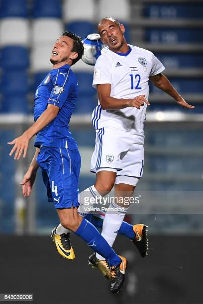 Matteo Darmian of Italy competes for the ball with Tal Ben Chaim of Israel during the FIFA 2018 World Cup Qualifier between Italy and Israel at Mapei...
