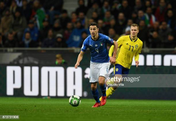 Matteo Darmian of Italy competes for the ball with Viktor Claesson of Sweden during the FIFA 2018 World Cup Qualifier PlayOff Second Leg between...