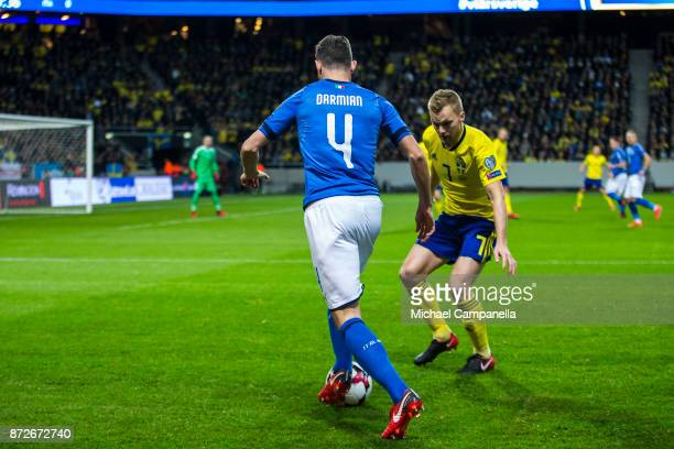Matteo Darmian of Italy in a duel with Sebastian Larsson of Sweden during the FIFA 2018 World Cup Qualifier PlayOff First Leg between Sweden and...