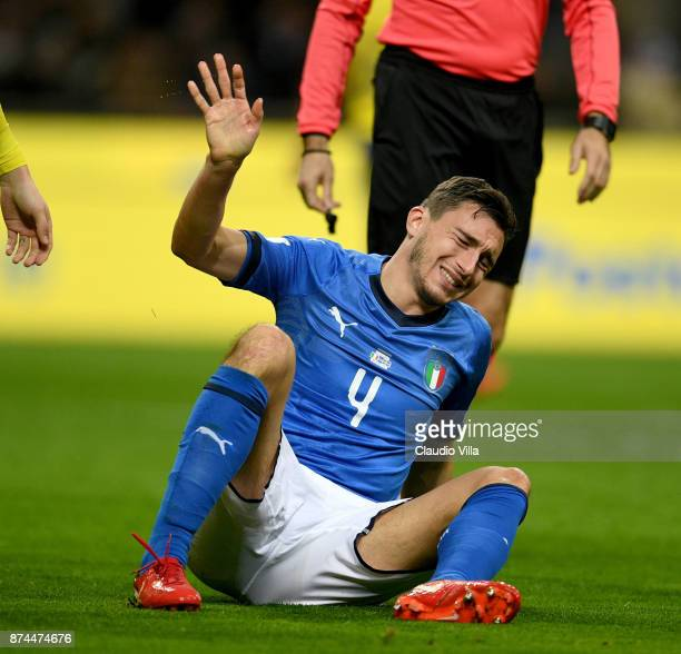 Matteo Darmian of Italy injured during the FIFA 2018 World Cup Qualifier PlayOff Second Leg between Italy and Sweden at San Siro Stadium on November...