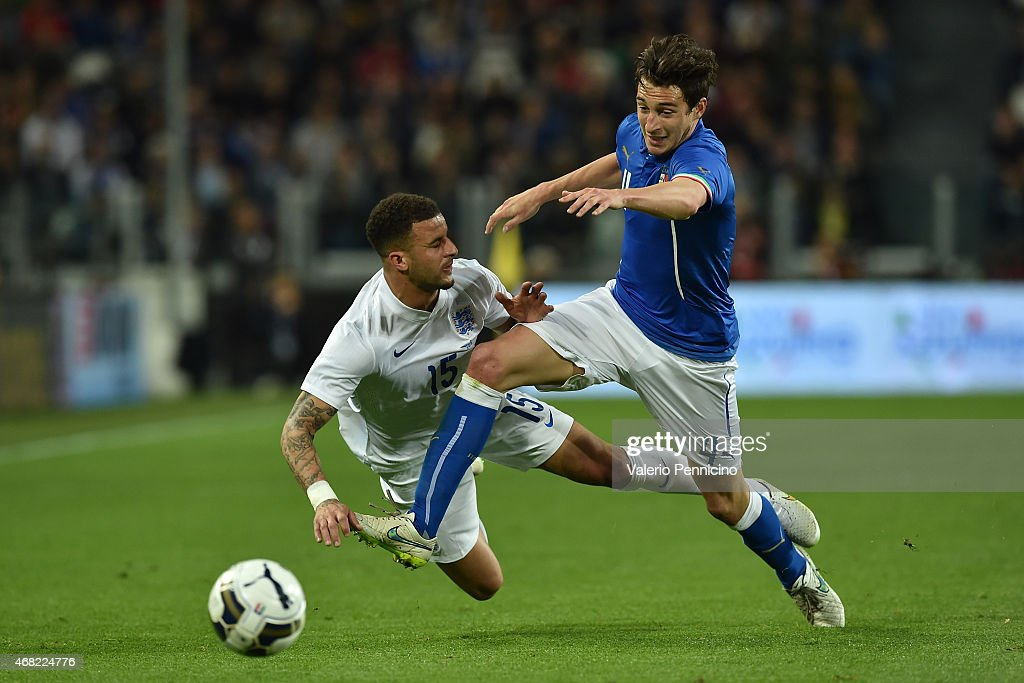<a gi-track='captionPersonalityLinkClicked' href=/galleries/search?phrase=Matteo+Darmian&family=editorial&specificpeople=7096006 ng-click='$event.stopPropagation()'>Matteo Darmian</a> (R) of Italy tackles <a gi-track='captionPersonalityLinkClicked' href=/galleries/search?phrase=Kyle+Walker&family=editorial&specificpeople=5609702 ng-click='$event.stopPropagation()'>Kyle Walker</a> of England during the international friendly match between Italy and England at the Juventus Arena on March 31, 2015 in Turin, Italy.