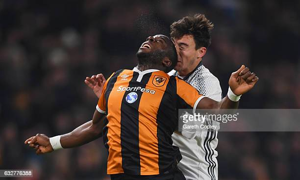Matteo Darmian of Manchester United and Adama Diomande of Hull City clash heads during the EFL Cup SemiFinal second leg match between Hull City and...
