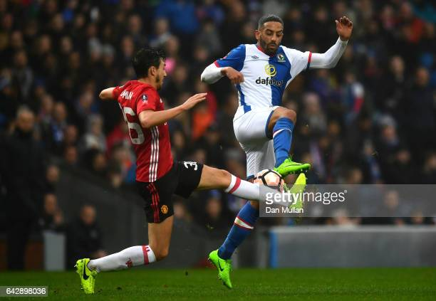 Matteo Darmian of Manchester United and Liam Feeney of Blackburn Rovers battle for the ball during The Emirates FA Cup Fifth Round match between...