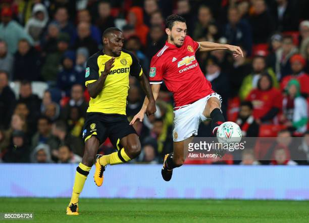 Matteo Darmian of Manchester United and Lloyd Dyer of Burton Albion battle for possession during the Carabao Cup Third Round match between Manchester...