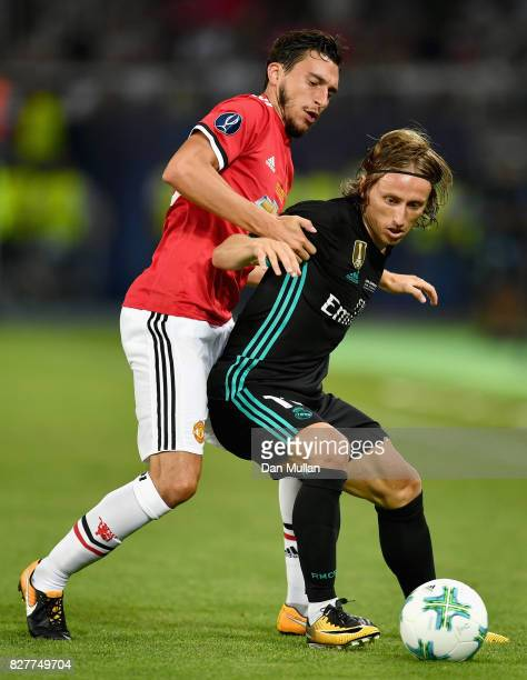 Matteo Darmian of Manchester United and Luka Modric of Real Madrid battle for possession during the UEFA Super Cup final between Real Madrid and...