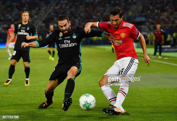 Matteo Darmian of Manchester United attempts to cross as Daniel Carvajal of Real Madrid attempts to block during the UEFA Super Cup final between...
