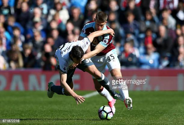 Matteo Darmian of Manchester United battles for the ball with Johann Gudmundsson of Burnley during the Premier League match between Burnley and...