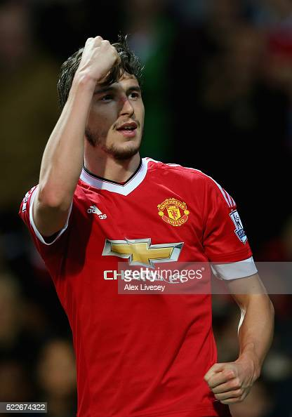 Matteo Darmian of Manchester United celebrates after scoring his sides second goal during the Barclays Premier League match between Manchester United...