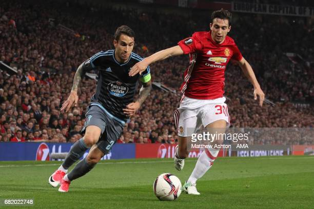 Matteo Darmian of Manchester United competes with Hugo Mallo of Celta Vigo during the UEFA Europa League semi final second leg match between...