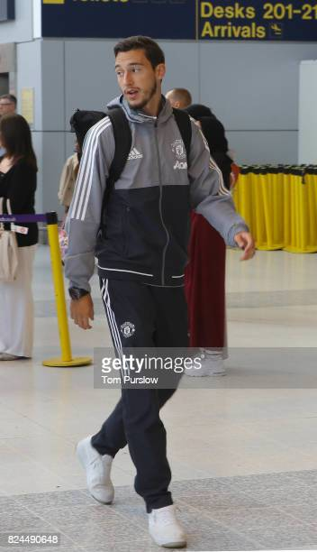 Matteo Darmian of Manchester United departs for the preseason friendly match between Valerenga and Manchester United at Manchester Airport on July 30...