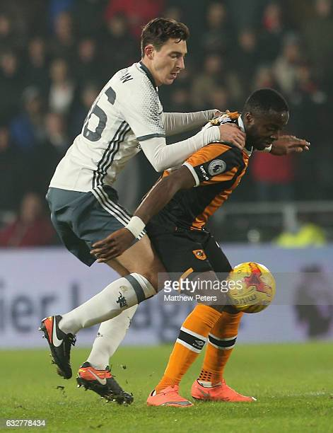 Matteo Darmian of Manchester United in action with Adama Diomande of Hull City during the EFL Cup SemiFinal second leg match between Hull City and...